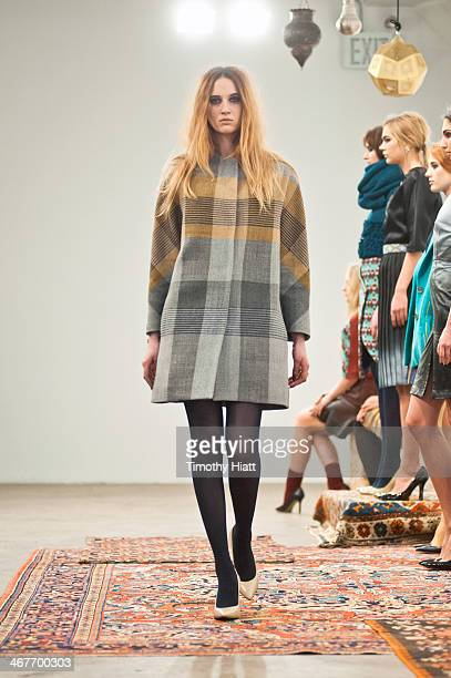 A model poses at the Harare presentation during MADE Fashion Week Fall 2014 at Highline Loft on February 7 2014 in New York City