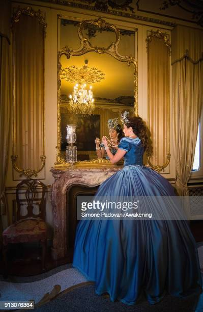 A model poses at the hystorical Ca' Nigra Palace wearing a Cinderella costume of the 1800s made with Rubelli silk on February 1 2018 in Venice Italy...