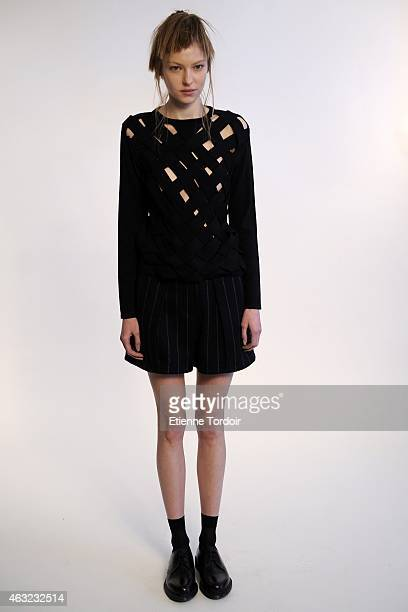 A model poses at the Ji Oh Presentation during MercedesBenz Fashion Week Fall Winter 2015 at Industria Studios on February 11 2015 in New York City