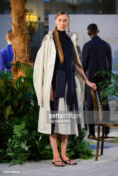 A model poses at the Johnstons of Elgin presentation during London Fashion Week September 2018 at Waldorf Hotel on September 14 2018 in London England