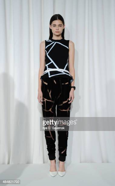 A model poses at the Jonathan Simkhai fashion show during MADE Fashion Week Spring 2015 at Milk Studios on September 6 2014 in New York City