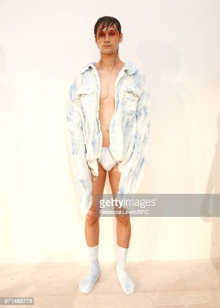Model poses at the Ka Wa Key DiscoveryLAB during London Fashion Week Men's June 2018 at the BFC Show Space on June 11, 2018 in London, England.