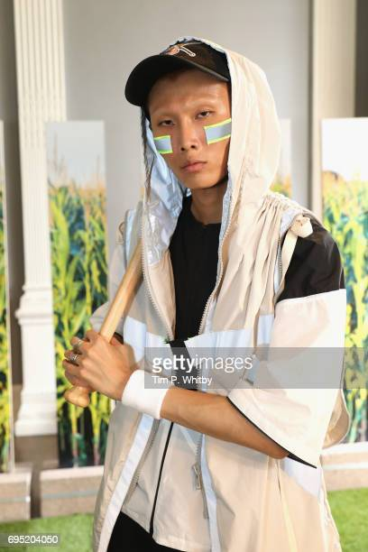 A model poses at the Michiko Koshino presentation during the London Fashion Week Men's June 2017 collections on June 12 2017 in London England