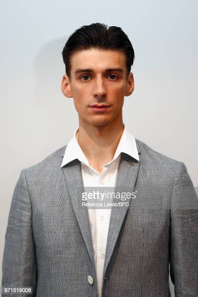 A model poses at the Mr Start presentation at the DiscoveryLAB during London Fashion Week Men's June 2018 at the BFC Show Space on June 11 2018 in...