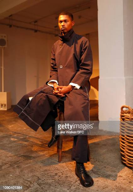 A model poses at the Omar Afridi presentation at the DiscoveryLAB during London Fashion Week Men's January 2019 at the BFC Designer Showrooms on...