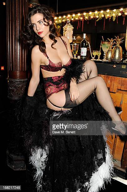 A model poses at the opening of the new Agent Provocateur boutique in Mayfair hosted by Josephine de la Baume on December 11 2012 in London England