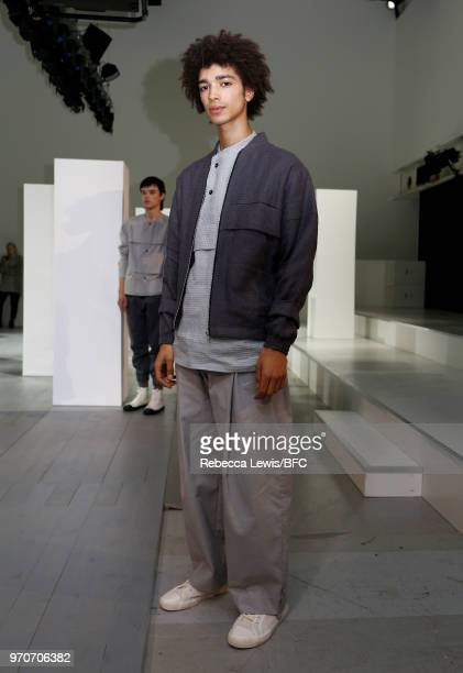 A model poses at the Phoebe English Presentation during London Fashion Week Men's June 2018 at BFC Show Space on June 10 2018 in London England