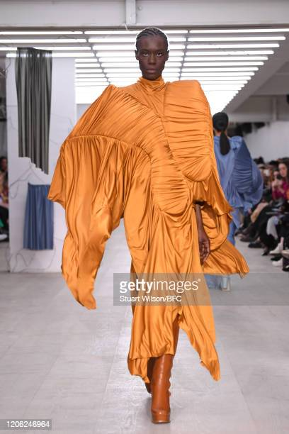 Model poses at the Richard Malone Presentation during London Fashion Week February 2020 on February 14, 2020 in London, England.