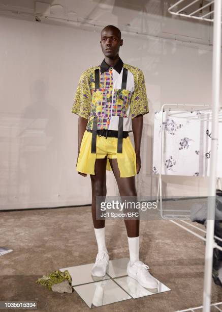 A model poses at the Underage presentation at the DiscoveryLAB during London Fashion Week September 2018 at the BFC Designer Showrooms on September...