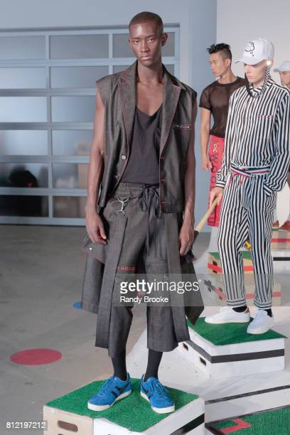 Model poses at the Wood House presentation during NYFW: Men's July 2017 at Dune Studios on July 10, 2017 in New York City.