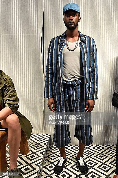 A model poses at the YMC during The London Collections Men SS17 on June 11 2016 in London England