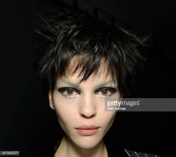 A model poses backstage ahead of Emporio Armani show during Milan Fashion Week Womenswear Autumn/Winter 2014 on February 21 2014 in Milan Italy