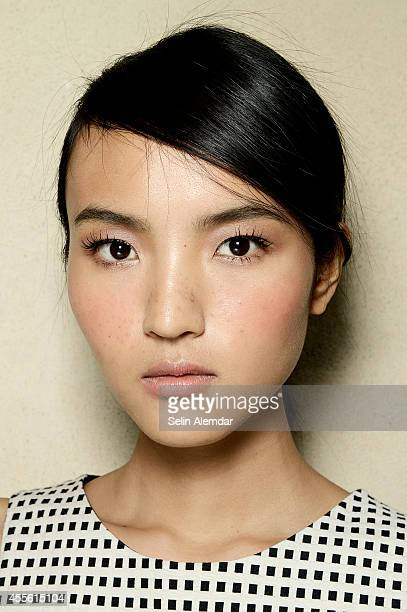 A model poses backstage ahead of I'm Isola Marras show during Milan Fashion Week Womenswear Spring/Summer 2015 on September 17 2014 in Milan Italy
