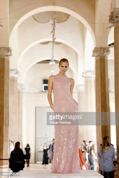 A model poses backstage ahead of the Alberta Ferretti show during Milan Fashion Week Spring/Summer 2018on September 20 2017 in Milan Italy