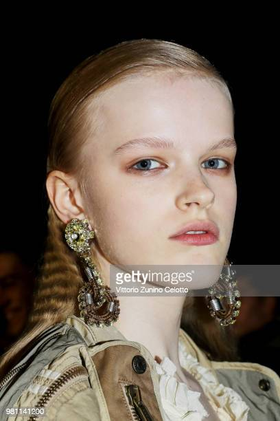 A model poses backstage ahead of the Dsquared2 show during Milan Men's Fashion Week Spring/Summer 2019 on June 17 2018 in Milan Italy