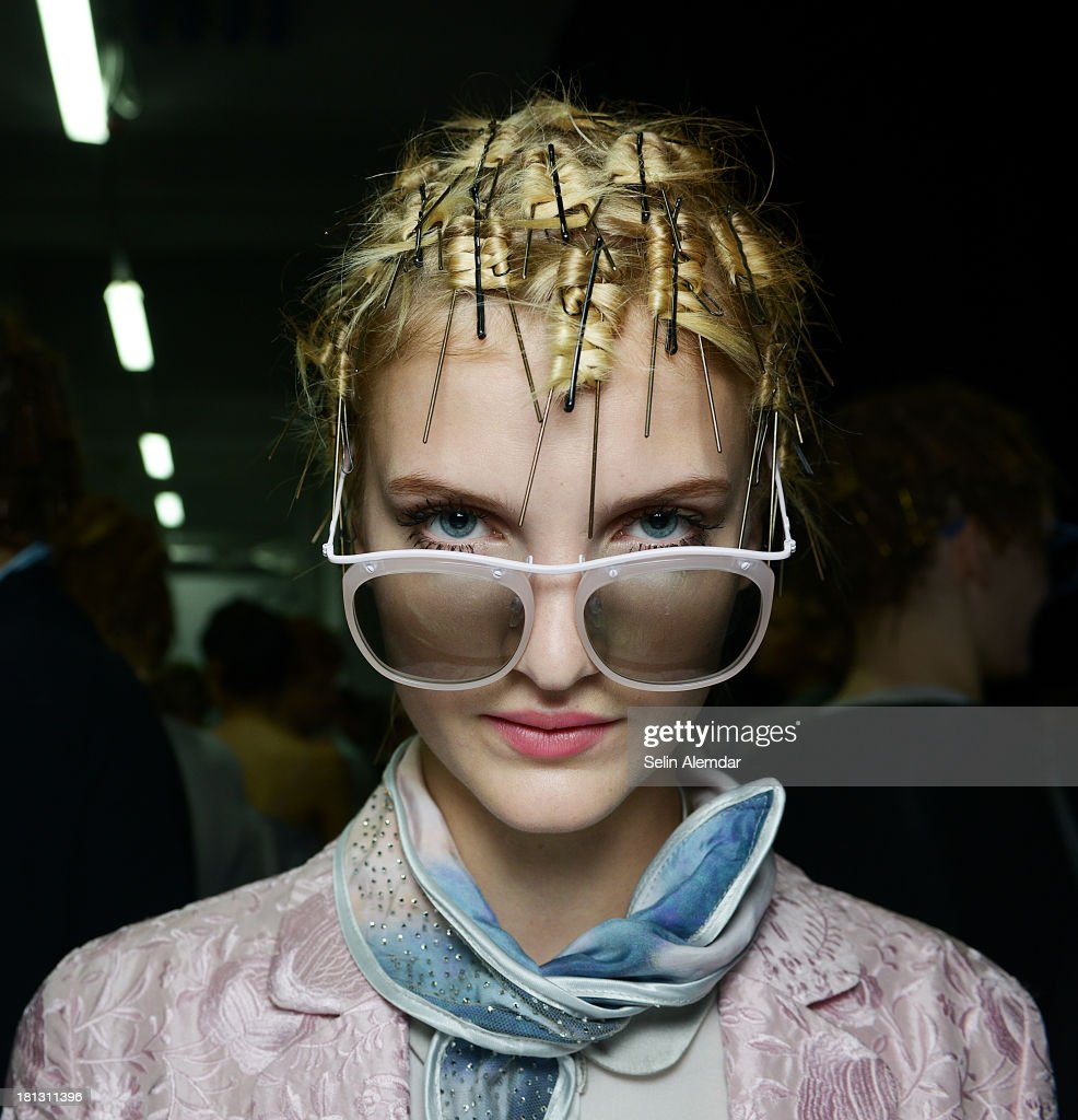 A model poses backstage ahead of the Emporio Armani show as a part of Milan Fashion Week Womenswear Spring/Summer 2014 on September 20, 2013 in Milan, Italy.