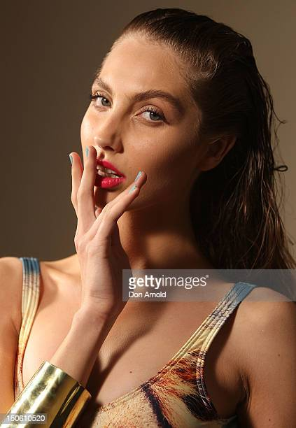 Model poses backstage ahead of the Fashion Week Highlight Show as part of Mercedes Benz Fashion Festival Sydney 2012 at Sydney Town Hall on August...