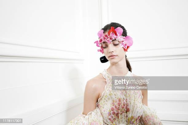 Model poses backstage ahead of the Giambattista Valli Womenswear Spring/Summer 2020 show as part of Paris Fashion Week on September 30, 2019 in...