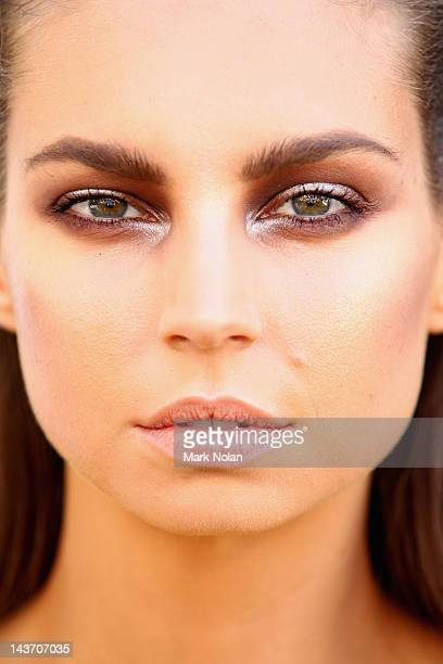 Model poses backstage ahead of The Innovaters show on day four of Mercedes-Benz Fashion Week Australia Spring/Summer 2012/13 at the Overseas...