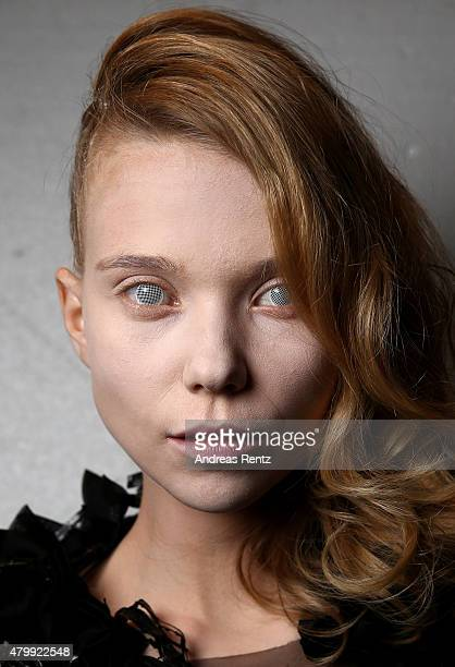 A model poses backstage ahead of the Irene Luft show during the MercedesBenz Fashion Week Berlin Spring/Summer 2016 at Brandenburg Gate on July 8...