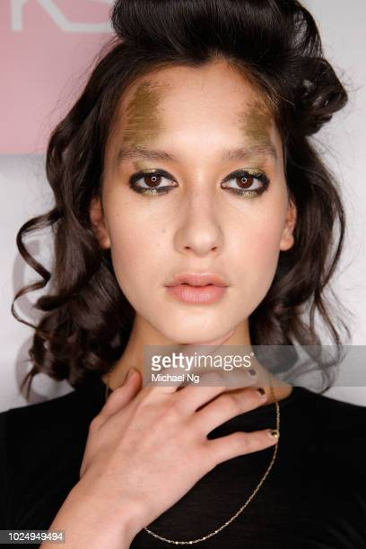 A model poses backstage ahead of the Jarrad Godman Contemporary Salon show during New Zealand Fashion Week 2018 at Viaduct Events Centre on August 29...