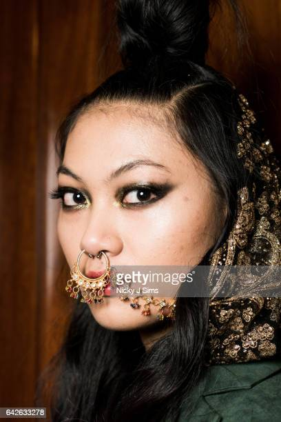 A model poses backstage ahead of the Limkokwing University show during the London Fashion Week February 2017 collections on February 17 2017 in...
