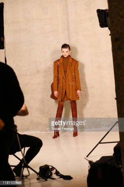 A model poses backstage ahead of the Max Mara show at Milan Fashion Week Autumn/Winter 2019/20 on February 21 2019 in Milan Italy