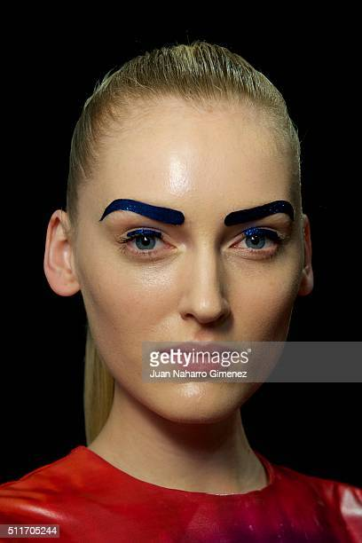 Model poses backstage ahead of the Maya Hansen show during the Mercedes-Benz Madrid Fashion Week Autumn/Winter 2016/2017 at Ifema on February 22,...
