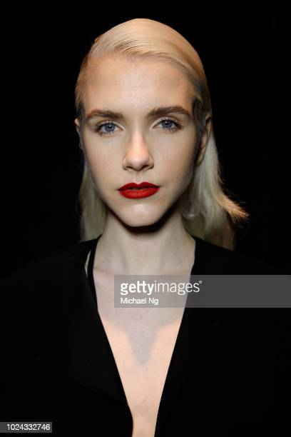 A model poses backstage ahead of the MercedesBenz Presents Knuefermann show during New Zealand Fashion Week 2018 at Viaduct Events Centre on August...