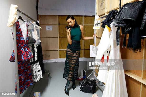 A model poses backstage ahead of the Teatum Jones runway show during London Fashion Week Spring/Summer collections 2017 on September 16 2016 in...