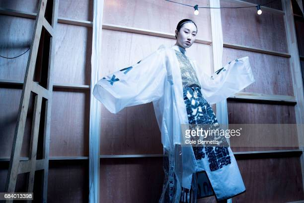 A model poses backstage ahead of the The Innovators Fashion Design Studio show at MercedesBenz Fashion Week Resort 18 Collections at Carriageworks on...