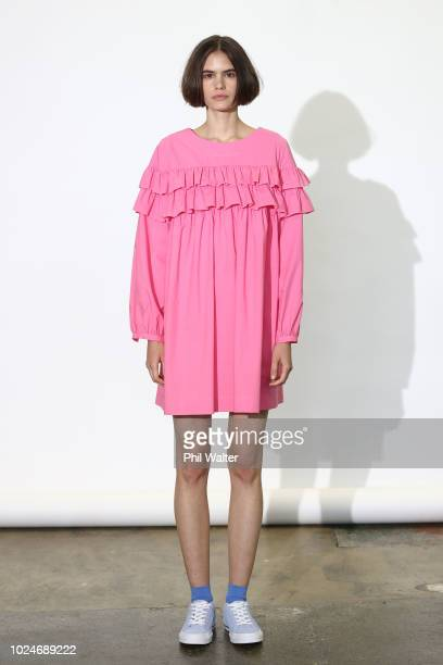 pink ruffled dress stock photos and pictures getty images