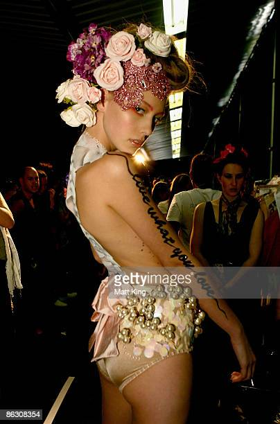 Model poses backstage ahead of the V Australia New Generation catwalk show at the Overseas Passenger Terminal, Circular Quay on day five of Rosemount...