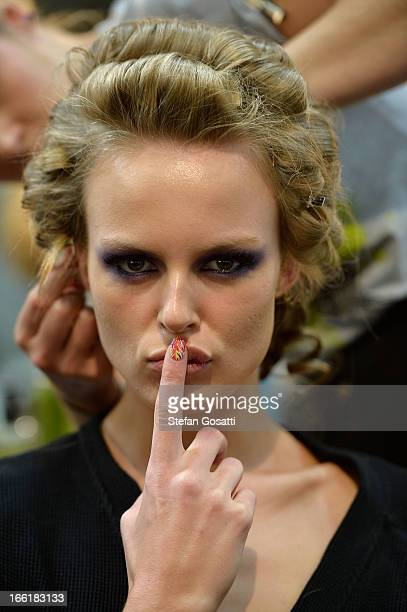 A model poses backstage ahead of the We Are Handsome show during MercedesBenz Fashion Week Australia Spring/Summer 2013/14 at Carriageworks on April...