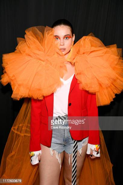 A model poses backstage as Cheetos unveiled faninspired versions of the #CheetosFlaminHaute look at The House Of Flamin' Haute Runway Show Style Bar...