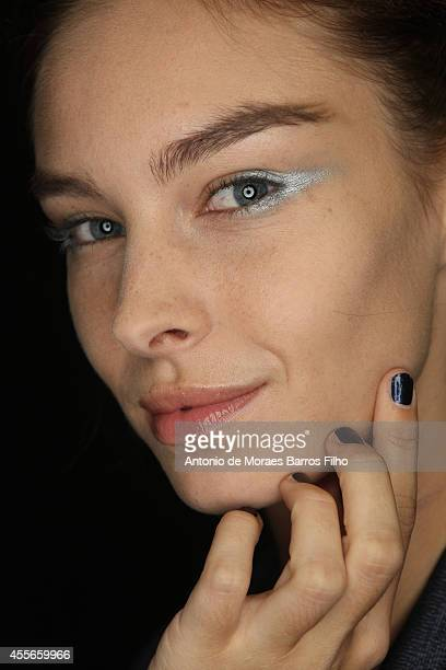 A model poses backstage at Emporio Armani show as a part of Milan Fashion Week Womenswear Spring/Summer 2015 on September 18 2014 in Milan Italy