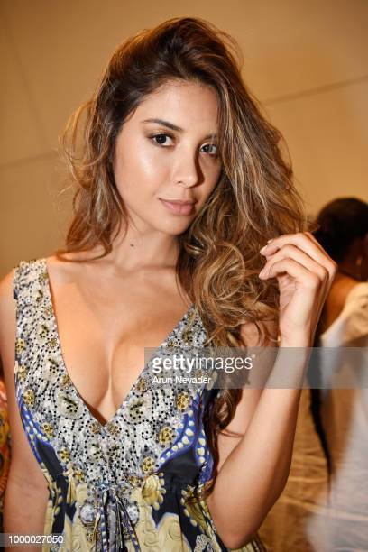 A model poses backstage at Miami Swim Week powered by Art Hearts Fashion Swim/Resort 2018/19 at Faena Forum on July 15 2018 in Miami Beach Florida