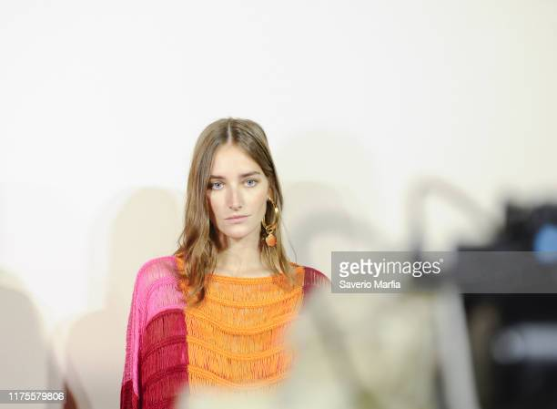A model poses backstage at the Alberta Ferretti show during the Milan Fashion Week Spring/Summer 2020 on September 18 2019 in Milan Italy