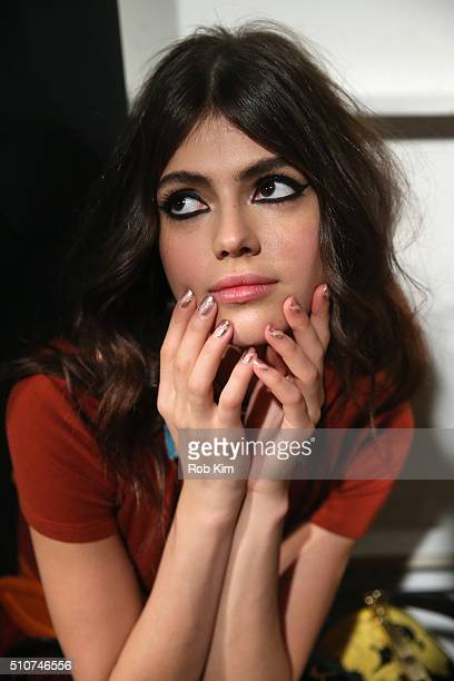 A model poses backstage at the alice olivia by Stacey Bendet Fall 2016 presentation at The Gallery Skylight at Clarkson Sq on February 16 2016 in New...