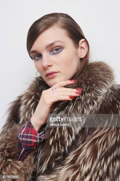A model poses backstage at the Calvin Luo fashion show during New York Fashion Week on February 13 2018 in New York City