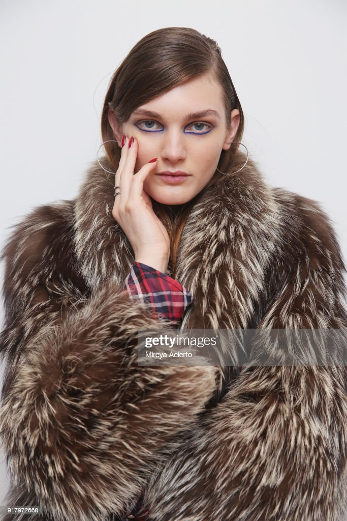 A model poses backstage at the Calvin Luo fashion show during New York Fashion Week on February 13, 2018 in New York City.