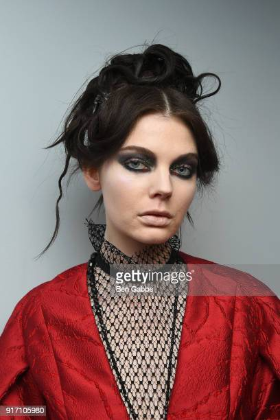 A model poses backstage at the Carmen Marc Valvo fashion show during New York Fashion Week on February 11 2018 in New York City