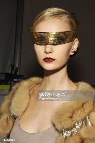 A model poses backstage at the Dennis Basso Spring 2010 during MercedesBenz Fashion Week at Bryant Park on September 15 2009 in New York City