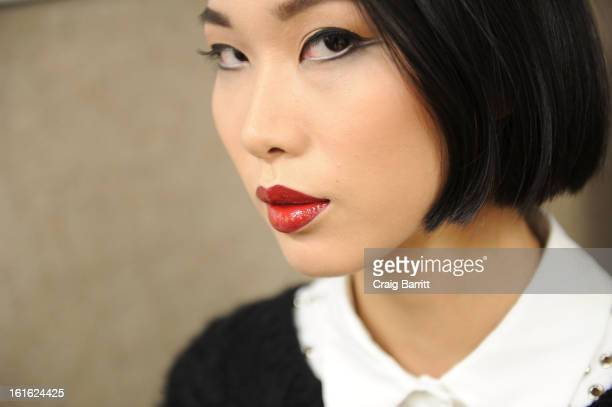 A model poses backstage at the Douglas Hannant fall 2013 fashion show during MercedesBenz Fashion Week at Dimenna Center for Classica Music on...