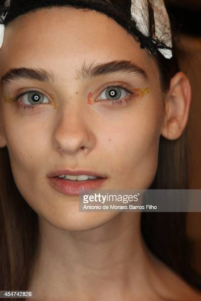 Model poses backstage at the Monique Lhullier show at Mercedes-Benz Fashion Week Spring 2015 at The Theatre at Lincoln Center on September 5, 2014 in...