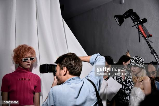 A model poses backstage before presenting creations by Annakiki during the Women's Spring/Summer 2019 fashion shows in Milan on September 19 2018