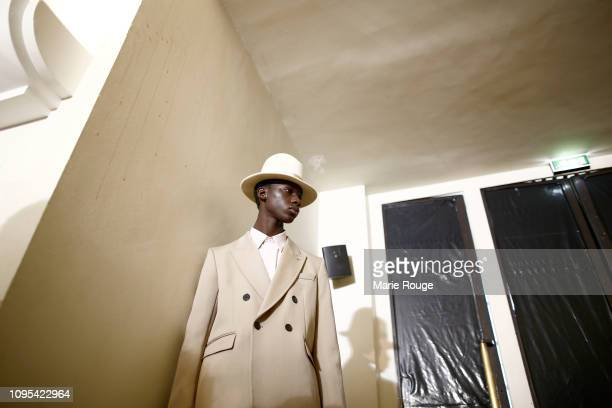 A model poses backstage before the Ami Alexandre Mattiussi Menswear Fall/Winter 20192020 show at Palais de Chaillot on January 17 2019 in Paris France