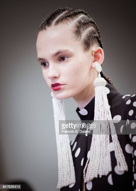 A model poses backstage before the Andrew Gn show as part of the Paris Fashion Week Womenswear Fall/Winter 2017/2018 on March 3 2017 in Paris France