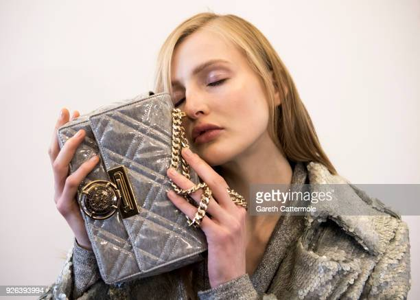 A model poses backstage before the Balmain show as part of the Paris Fashion Week Womenswear Fall/Winter 2018/2019 on March 2 2018 in Paris France