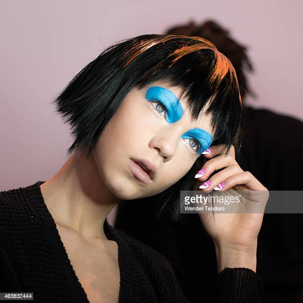 A model poses backstage before the Jeremy Scott fashion show at Milk Studios during MADE Fashion Week Fall 2015 on February 18 2015 in New York City